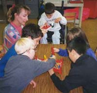 Photo of younger students working together